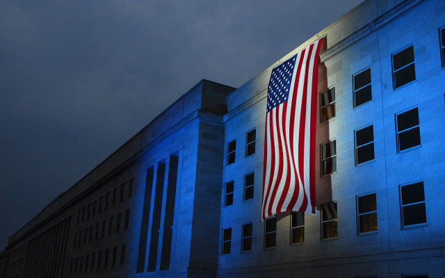 070911-N-0962S-032  WASHINGTON (Sept. 11, 2007) - A memorial flag is illuminated near the spot where American Airlines Flight 77 crashed into the Pentagon on Sept. 11, 2001. Secretary of Defense Robert Gates is scheduled to host the Pentagon Sept. 11 Memorial observance for family members of those who were killed in the Sept. 11 attack on the Pentagon. U.S. Navy photo by Mass Communication Specialist 1st Class Brandan W. Schulze (RELEASED)